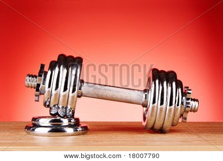 Dumbbell on red background