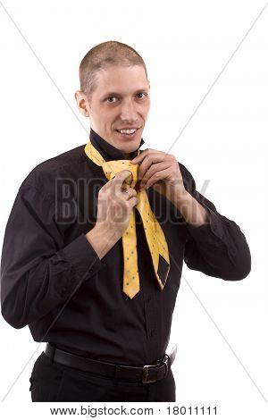 Man Makink A Tie