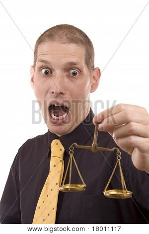 Business Man Holding A Justice Scale