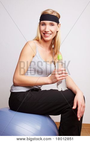 Woman On Gym Ball With Water Bottle