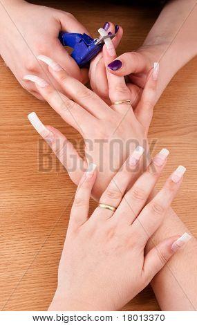 Manicurist Trimming Nail