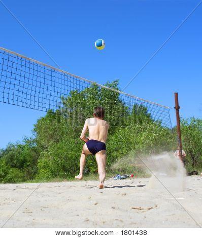 Playing Beach Volleyball - Man Runs After Ball