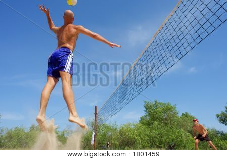 Men Playing Beach Volleyball - Balding Guy Jumps In A Funny Way To Hit A Ball