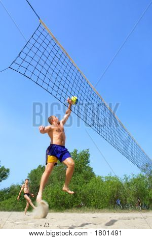 Two Men Playing Beach Volleyball - Fat Man Jumps Nice To Push The Ball, Short Man Helps Him