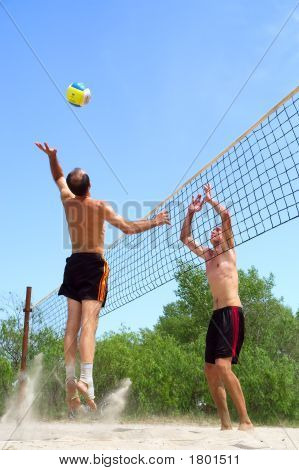 Two Men Playing Beach Volleyball - Short Balding Man Wins Over Tall Man