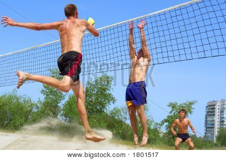 Three Men, Clumsy, Fat And Handsome, Play Beach Volleyball (Focus On Second Closest One)