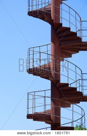 Staircase To Heaven - Old Rusty Spiral Stairway Against Sky