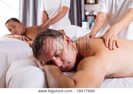 man and woman having massage in spa salon