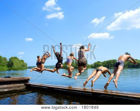 'Seven Samurai' - Group Of Kids Jumping Into Water From Pier