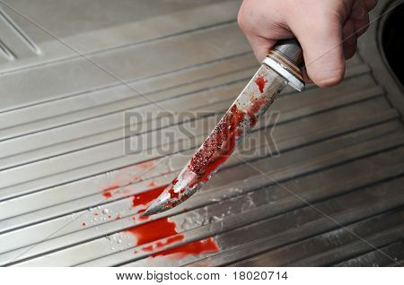 Hand With Bloody Knife