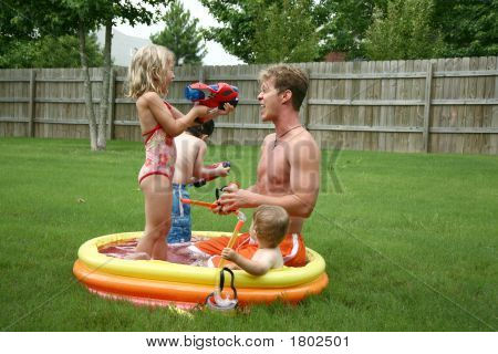 Backyard Family Fun In The Kiddie Pool.