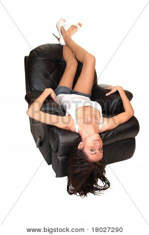 Girl Lying On Armchair.