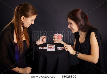 Two Girls Friends Engaged In Fortune-telling Cards