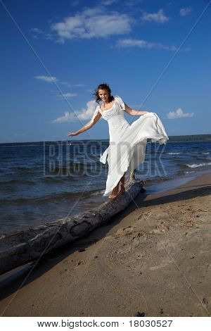 Bride Balancing On Trunk