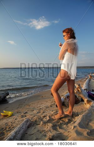 Bride Smoking On Seashore