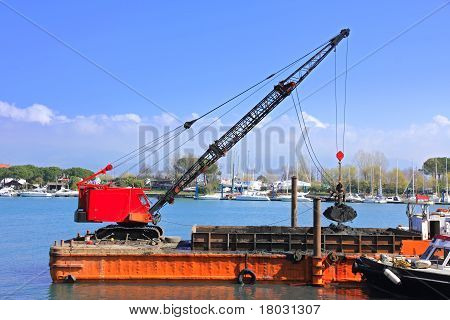 Dredger In Harbor