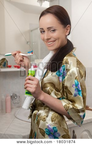 Young Woman With Toothbrush.