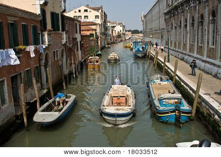 beautiful colored houses and a canal seen from an old brigde of the old fishermans city Burano in th