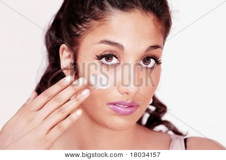 Girl applying face cream