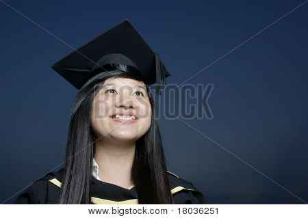 Smiling asian lady graduate