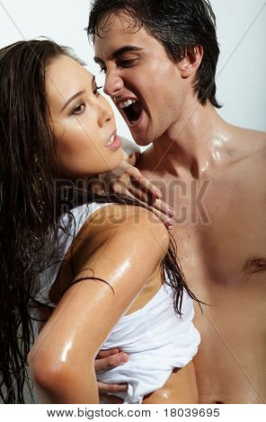Portrait of wet passionate man shouting while looking at beautiful female