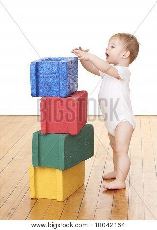 Boy Stacking Colorful Blocks