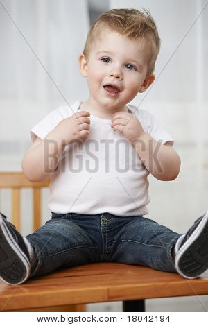 Toddler Boy On Table