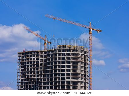 Building Crane And Building Under Construction