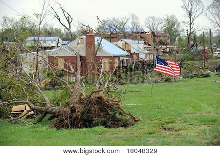 SAINT LOUIS, MISSOURI - APRIL 24: A US flag flies amidst damaged homes  after tornadoes hit the Bridgeton area on Friday April 22, 2011 in Saint Louis, Missouri  on April 24, 2011
