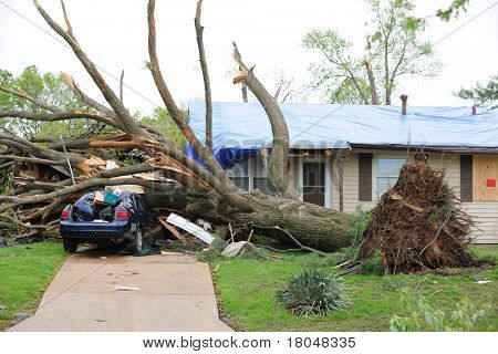SAINT LOUIS, MISSOURI - APRIL 23: Damaged home with tarp-covered roof after tornadoes hit the Maryland Heights area on Friday April 22, 2011 in Saint Louis, Missouri  on April 23, 2011