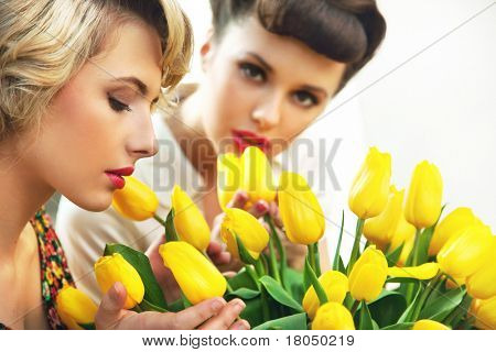 Two flower nymphs and a bunch of tulips