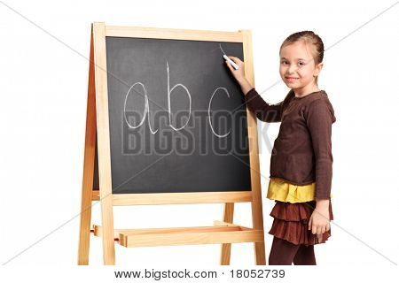 A child writing letters on a school board isolated on white background