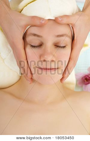 Man's Hands Do Woman's Face Massage