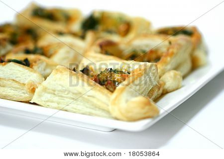 Close up:Vegetable stuff in filo pastry with sprinkle of cheese on white background
