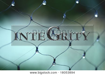 Sign : Word ' Integrity ' with fence with droplets as background