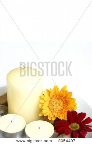 Isolated pebbles, candles and flower background on white room for text.