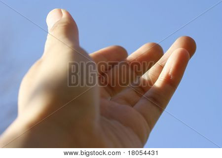 Hand of faith : A hand stretched out towards the sky, showing generosity, warmth and friendliness