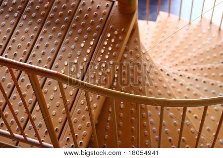 Step down. An orange spiral staircase.