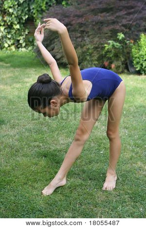 A young girl practicing her ballet dance moves