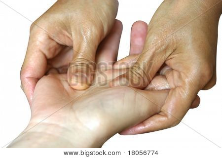 A lady receiving a hand massage as part of a holistic massage treatment, isolated on white.