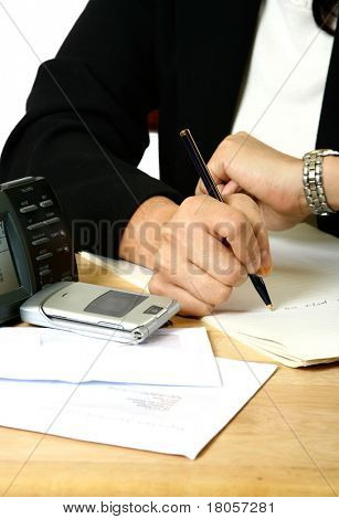 A businesswoman keeping an eye on the time as she rush to meet the deadline, isolated on white.