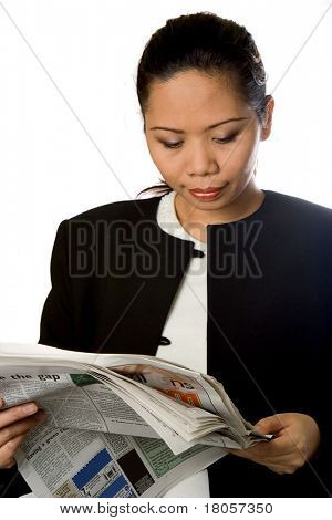 Businesswoman catching up on the worldly news, reading her newspaper, over white.