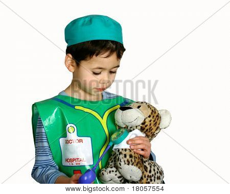 A young boy dressing up as a doctor, pretending to check on his patient, a stuff leopard.