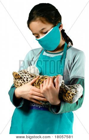 A young girl pretending to be a nurse/doctor , playing dressing up, isolated on white.