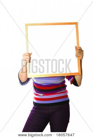 A woman holding out a wooden frame with empty space, replaceable with any image.