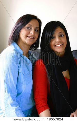 Portrait of beautiful mother and daughter of Asian origin.Concept of diversity and family value.
