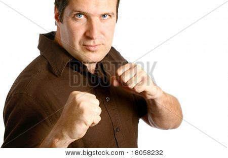 Masculine man in boxing stance, isolated on white.