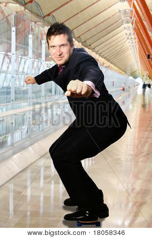 Businessman on skateboard against modern interior.