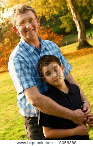Caucasian father with his beautiful son from inter marriage, enjoying the outdoor autumn park