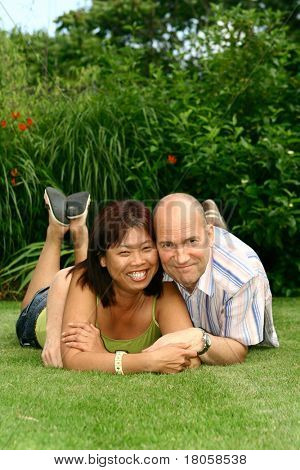 Caucasian man with chinese partner, enjoying the garden. Concept of diversity and harmony.